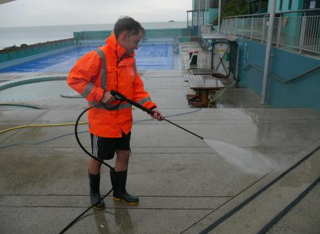 St Clair Hot Salt Water Pool duty supervisor Tait Familton prepares the pool for its opening day...