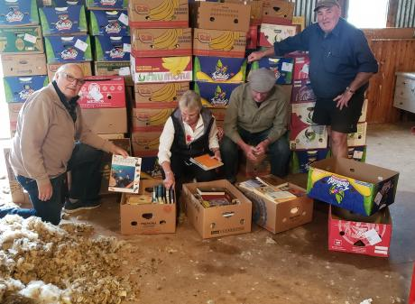 Organising books for the Rotary Club of Taieri's upcoming book sale are (from left) Phil Farquar,...