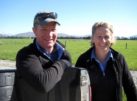 Angus and Elise Aitken with their son George. The couple have mapped out an impressive irrigation...