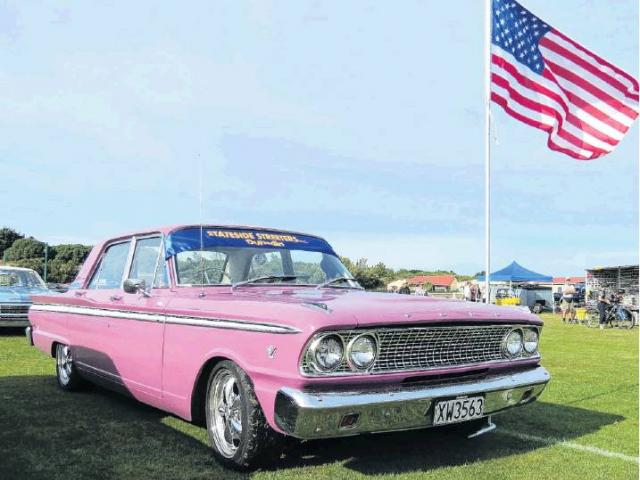 Pretty in pink . . . A 1963 Ford Fairlane, complete with American flag, on display at a previous...