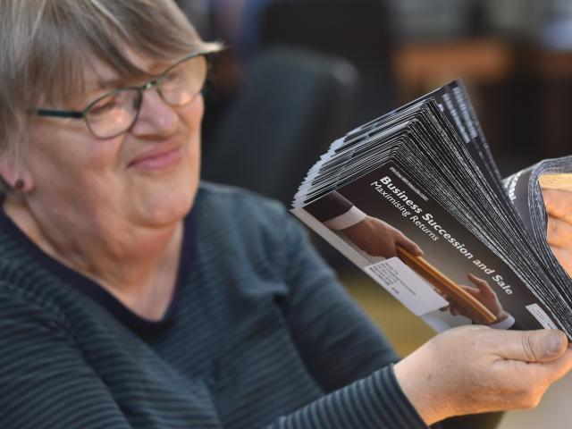Jacqueline Hewson does some postal sorting. PHOTO: PETER MCINTOSH
