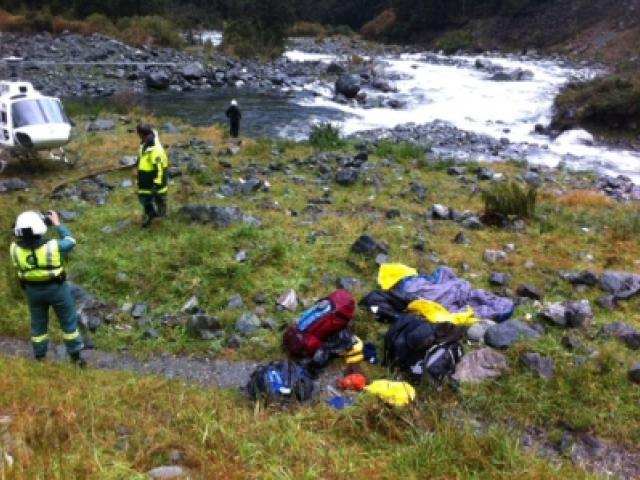 Searchers in the area from which the tramper was swept away. Photo from NZ Police