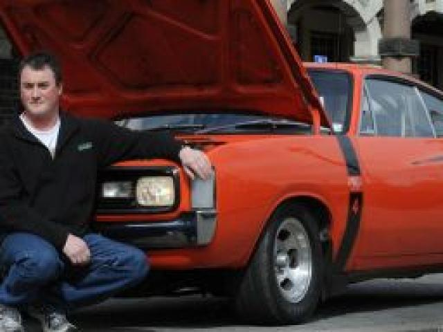 Glen Rayner with his 1972 Chrysler Valiant Charger R/T E49 outside the Dunedin Railway Station. Photo by Peter McIntosh.