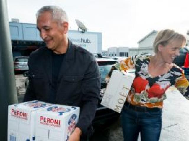 Hilary Barry and Mike McRoberts arrive at TV3 with a car boot full of celebration drinks. Photo: NZ Herald