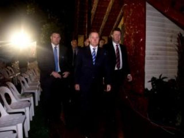 Prime Minister John Key (C) and Labour leader David Cunliffe (R) attend the Waitangi Day dawn service held at the treaty grounds marae at Waitangi. Photo / Dean Purcell