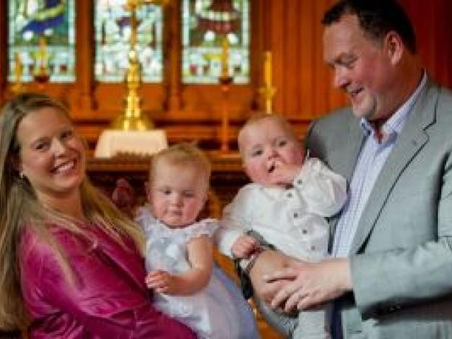 Jane and Martin Weekes had twins Parker (with Martin) and Poppy christened. Photo NZ Herald