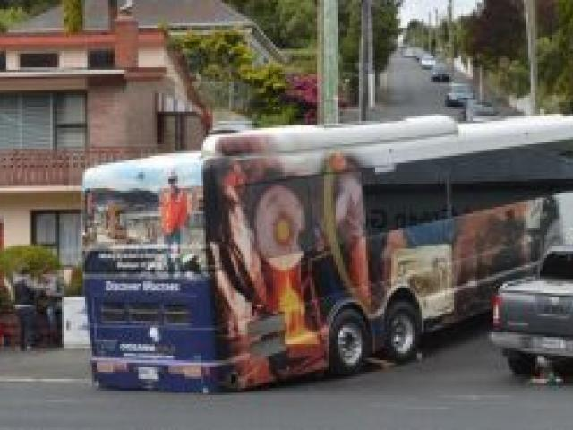 The tour bus ran aground while trying to negotiate a corner into Blacks Rd on Saturday. Photo by Gerard O'Brien.