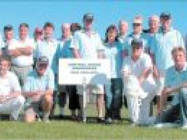 Well-travelled:The Central Otago Wanderers cricket team and supporters on their home wicket at Clyde.