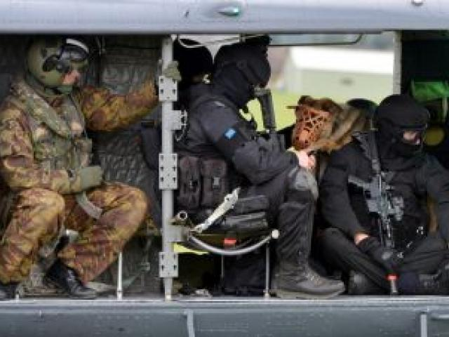 Armed offenders squad members and Royal New Zealand Air Force personnel prepare to leave Taieri airfield for an undisclosed location on the Taieri.  Photo by Stephen Jaquiery.