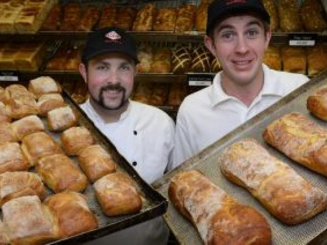 New World supermarket bakers Sean Jackson (left) and Michael Murphy finish a day's work before heading to Auckland to compete in the final of the 2013 New Zealand Young Bread Baker of the Year competition. Photo by Peter McIntosh.