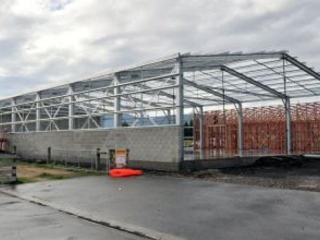 Bremca Otago's new building is underway in Dukes Rd. Top, Ben Baxter. Photo by Linda Robertson.