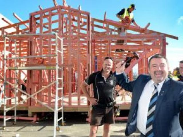 Standing in front of the house to be completed over the next two weekends are (from left) Certified Builders Association of New Zealand  southern region board member Dallas Shaw, Richard Stringer, of Harcourts Dunedin, and Mitre 10 Mega Dunedin chief exec
