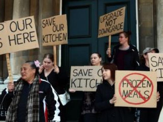Dunedin Hospital kitchen workers rally outside the Dunedin Municipal Chambers before a health board meeting last night. Photo by Peter McIntosh.