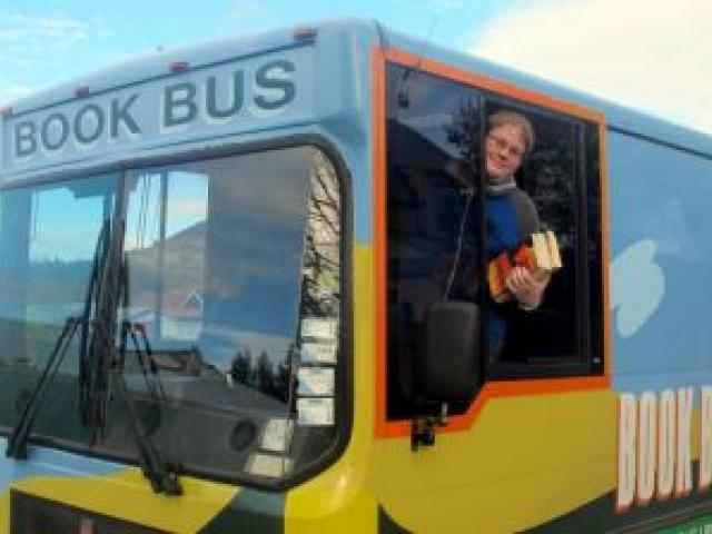 Dunedin library services senior library assistant David Kellett in the Bookbus at the Willow Park stop in Mosgiel last Wednesday. Photo supplied.
