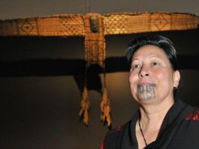 Toitu Otago Settlers Museum public programmes developer Rua McCallum reflects on a recently-installed Maori kite. Photo by Linda Robertson.