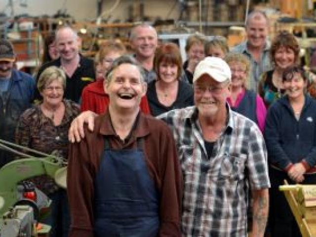 James Eason (front, left) and Gary Clark celebrate the end of more than 40 years together on the factory floor at McKinlays Footwear, in South Dunedin. Photo by Peter McIntosh.