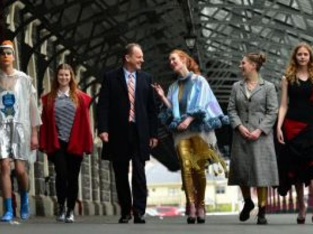 Labour Party leader David Shearer (centre) struts his stuff at the Dunedin Railway Station yesterday with Dunedin fashion designers and models (from left) Duncan Chambers-Watson, Abram Hunter, Mandy Myles, Lily Van Buskirk, Hannah Heslop, Emily Williams a