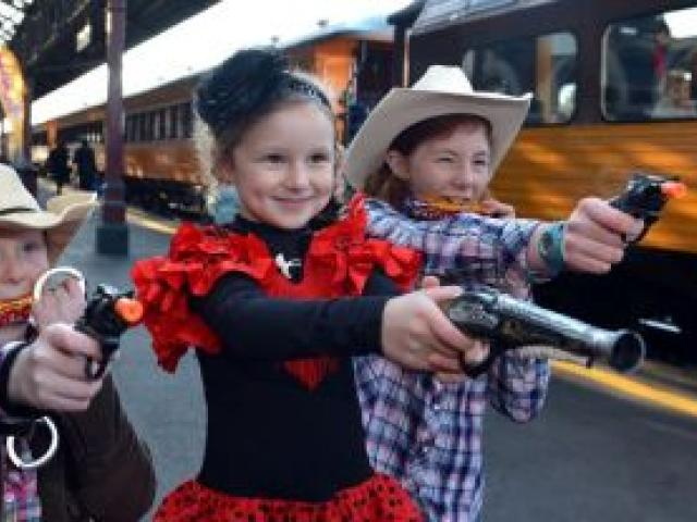 Ready to go on the Taieri Gorge Railway Crunchie Bar train ride yesterday are (from left)  Laura (8), Caitlyn (5) and Annabelle (10) Ring, of Dunedin. Photo by Peter McIntosh.