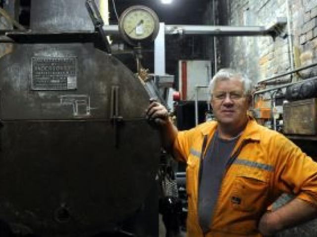 Dunedin Gasworks Museum engineering team co-ordinator Tom Galletly stands beside the earlier 1960s smokebox, now attached to a new oil-fired boiler. Photo by Craig Baxter.
