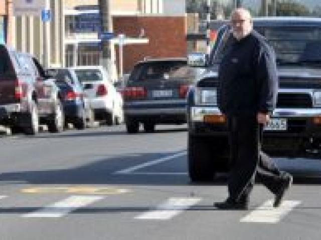 Neville Poole wants action on the Green Island pedestrian crossing. Photo by Craig Baxter.