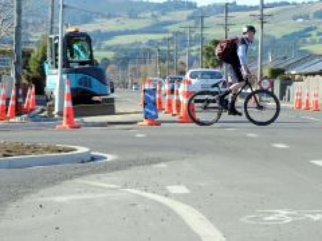 A cyclist crosses at the new roading layout and kerbing on the corner of Factory Rd and Elgin Pl, Mosgiel.  Photo by Craig Baxter.