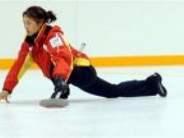 Training at the Dunedin Ice Stadium yesterday are Chinese curlers Qingshuang Yue (left) and skip Bingyu Wang.