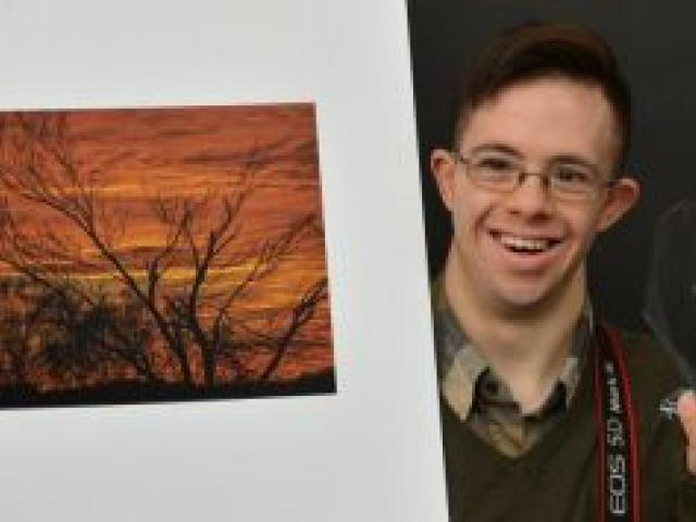 Carlos Biggemann displays his winning print and trophy from the international section of the My Perspective, United Kingdom Down Syndrome Association photography competition. Photo by Gerard O'Brien.
