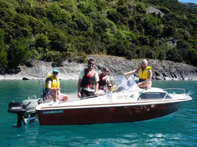 Anglers on Lake Wakatipu soaking up the sun and enjoying the fishing opportunities.