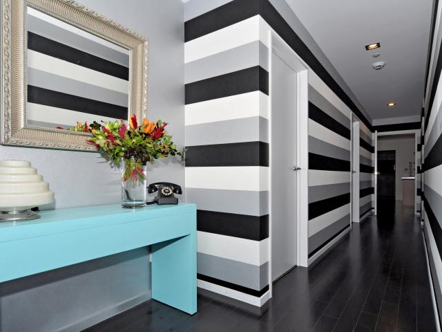 Striped Resene wallpaper hung sideways makes a feature of this hall, complemented by Resene...