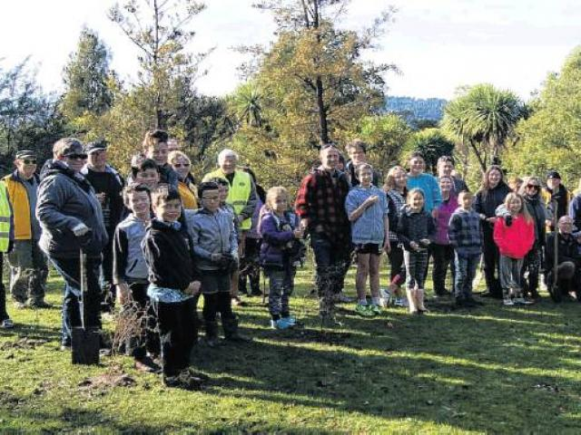 Unselfish act . . . People prepare to plant trees in the Town Belt. PHOTO: SUPPLIED