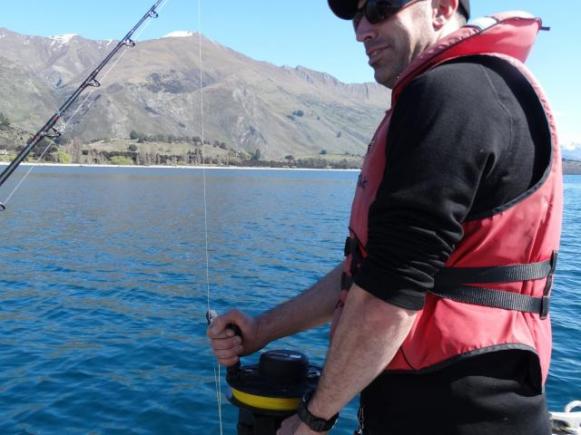 Environmental officer Nathan Manning uses a hydro-lab to measure the pH and oxygen levels of the...