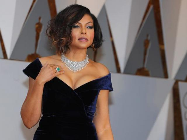Hidden Figures star Taraji P. Henson poured into a cleavage-bearing midnight blue Alberta Ferretti gown with a daring split at the leg. Photo: Reuters