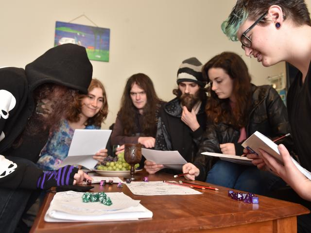 Dungeons & Dragons players (from left) Morgan Stanley (19), Jasmine Mawson (21), Daniel Stride (34), Steven Hindle (26), Jess Keogh (24) and Rowan Stanley (24) satisfy their thirst for fantasy. Photos by Peter Mcintosh.