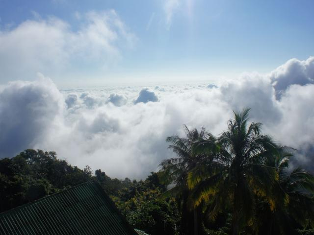 The Lanna capital of Chiang Mai emerges from the clouds in Thailand's mountainous jungled north....