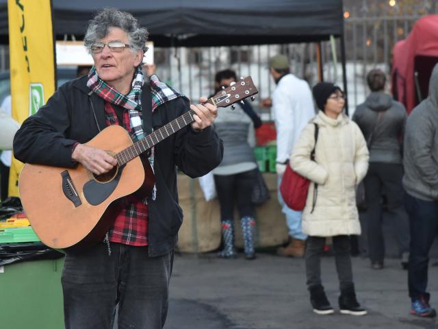 Mike Smith busks at the Dunedin Farmers Market. Photos: Craig Baxter