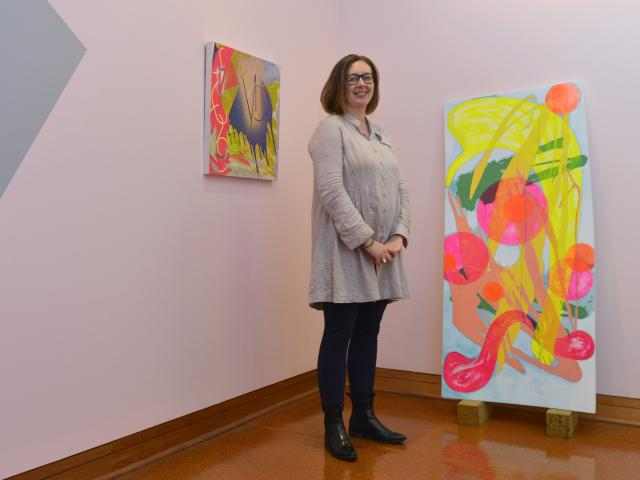 Miranda Parkes takes a break from hanging her exhibtion ''The Merrier'' at the Hocken Library. Photo: Gerard O'Brien