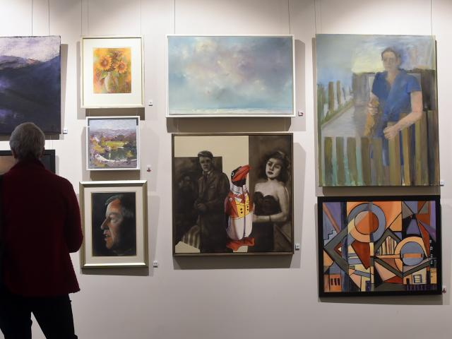 Janet Farquharson, of Dunedin, admires artwork at the Edinburgh Realty Premier Art Awards...