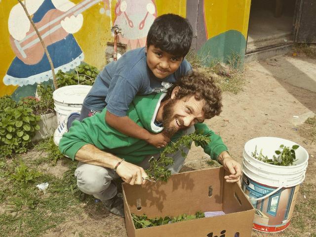 Ben Whitaker gets some assistance with gardening in Monte Chingolo, Argentina. Photo: Supplied