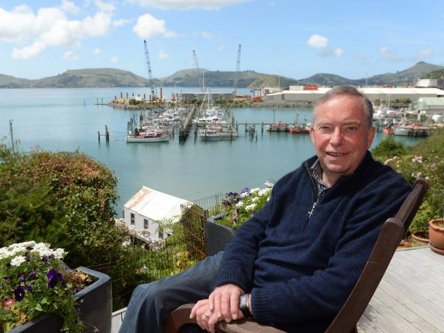 Former Dunedin city councillor Paul Hudson at his Careys Bay home. Mr Hudson says despite the many changes during the 45 years he has lived there, Careys Bay is still one of the best places in Dunedin to live. Photo: Linda Robertson