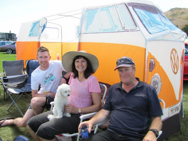 Peter Lobb (left) is joined by Allison and Ron Tapp, all of Dunedin, in front of Mr Lobb's VW...