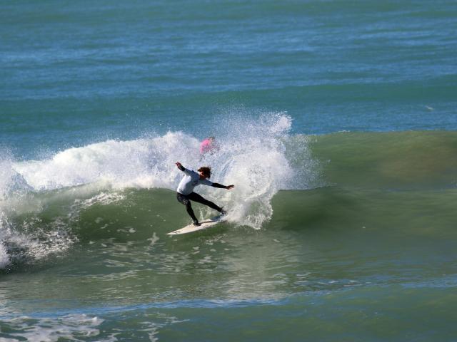 Dunedin surfers Elliott Brown (under-18 boys), Josh Thickpenny (over-30 men) and Jack McLeod ...