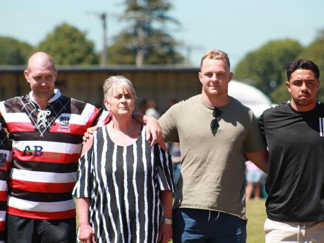 Blair Vining lines up for the national anthem with his mother Pauline and All Blacks players ...