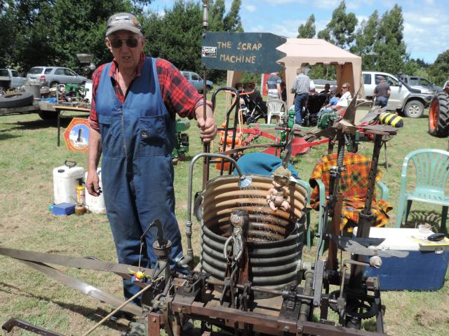 """Brian Smith, of Winchester, intrigued the crowd with his """"scrap machine'' powered by a pump made from a Stirling hot air engine."""