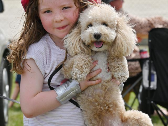 Georgie Jakeway (5), of Dunedin, and dog Rosie enjoy a picnic at a family reunion during the...
