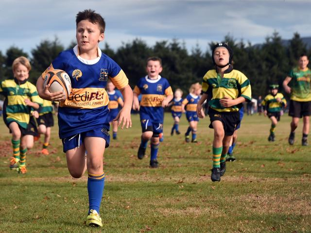 Zepplin Wylie-Strachan (7), of Taieri, is too quick for the Green Island defence.