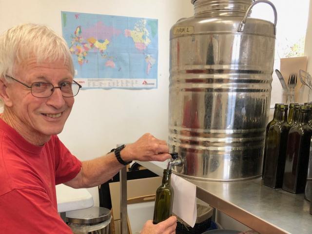 Tony Lawrence bottles Aurum's olive oil. PHOTOS: CHARMIAN SMITH