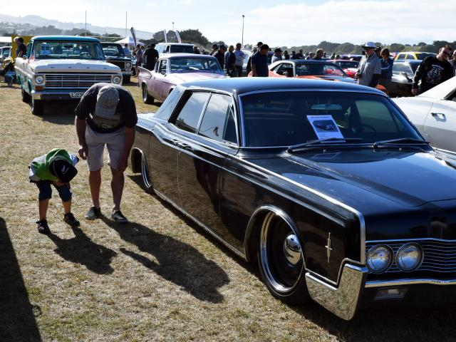 Intriguing . . . Blake Gaston (then 6), of Wingatui, gives his father the low-down on a 1966...