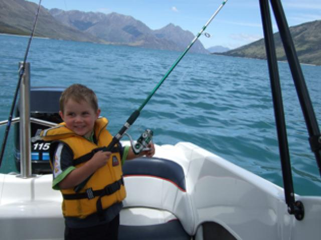 If only . . . Troy Sharman (3), left, at Kid Bush camping area, wishes he caught the fish that...