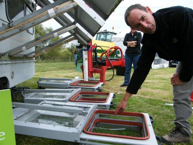 AgResearch soil scientist Tony van der Weerden demonstrates specially designed chambers to allow...