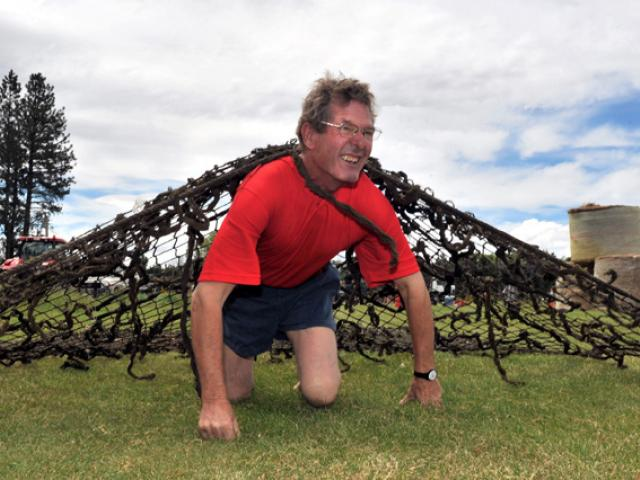 Allan Paterson, from Gimmerburn, tackles the obstacle course.